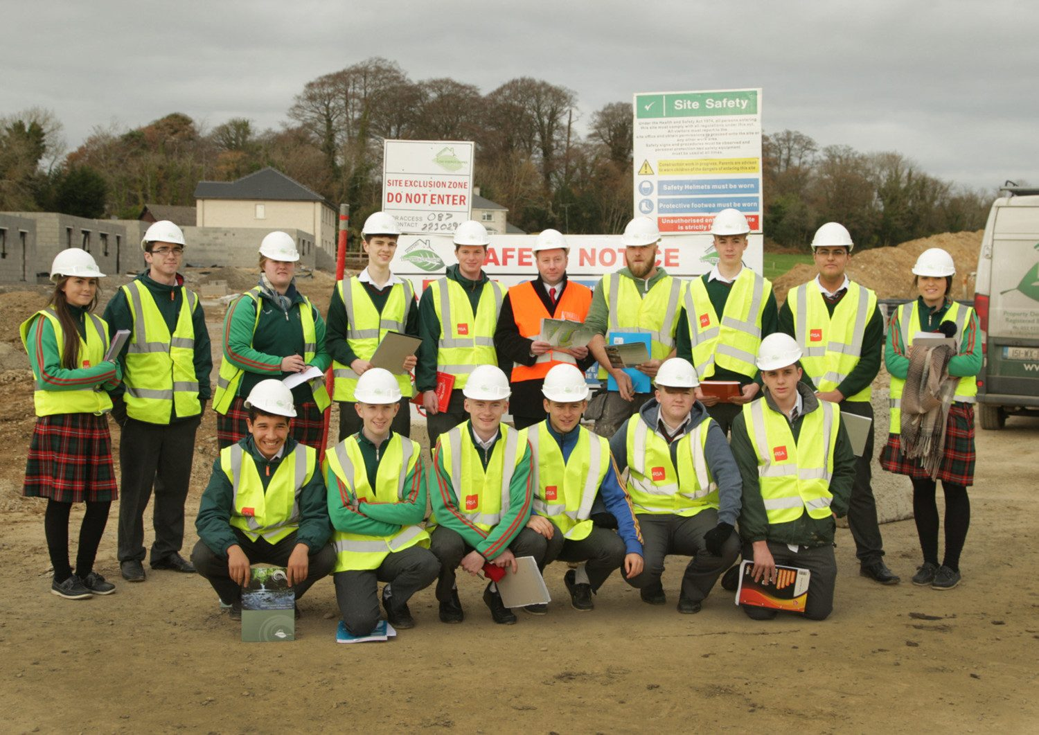 Gorey Community school construcion studies students visit, Gleann an Ghairdin; pictured with, selling agent, Michael Kinsella, Kinsella Estates and site manager, Nicky Morrissey, Wexford Low Energy Homes.